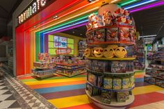Suspended from the main ceiling, this rainbow portal speaks of the statement of entrance, welcoming shoppers of all age to explore more into the store.