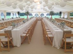 A beautiful, full canopy of our white paper lanterns fill this marquee. Add soft shades of flowers on the tables and at either end of the top table to create this beautiful relaxed, elegant look.