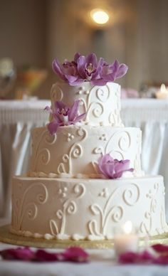 buttercream cake with purple flowers