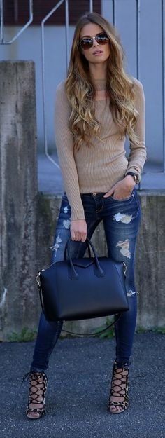 Josefin Ekström wears funky strapped heels with distressed jeans and a simple beige top.  Top & Bag: Chiquelle, Jeans: Gina Tricot.
