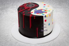 Yin Yang Cake: My clever client/friend came up with this awesome design for a birthday cake for her Twins - one boy and one girl both with different tastes...I really love this concept - Assassins Creed inspired on one side and rainbow confetti lovehearts on the other.