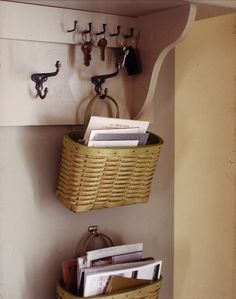 Another organizing idea for the entry is to use hanging baskets. These natural woven baskets look great on the wall, and the hooks are easily installed.  They're perfect for sorting mail.