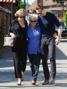 Meet the parents! Taylor Swift walked arm-in-arm with Tom Hiddleston and his mother Diana Hiddleston as the new couple travelled to the UK so he could introduce the singer to his family