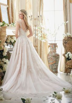 Elaborately Beaded Embroidery on Soft Tulle Ball Gown Wedding Dress Designed by Madeline Gardner. Colors Available: White/Silver, Ivory/Silver, Ivory/Blush/Silver
