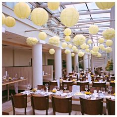 Unique hanging lanterns bring an oriental and elegant theme to your wedding