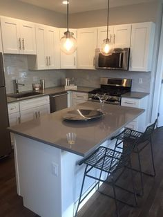 MY FUTURE KITCHEN!! Love the white cabinets, grey quartz counters, and marble slab backsplash!