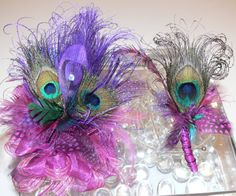 who says you have to have flowers? these would so great - and there are so many different kinds of feathers to choose from!