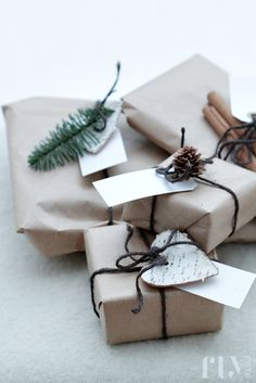 """I love using brown paper to wrap gifts. I have my kids stamp a design with one of the stamps from our collection. They will add just a simple """"quote"""" to the top of the gift or go hog wild and stamp away with a variety of engravings and colors. So simple and great way to involve kids. Another use for brown paper wrap up with kitchen string, yarn or extra embroidery thread and add a sprig of fresh rosemary."""