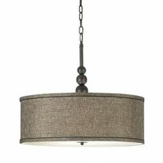 """Three-light pendant with a drum shade and oil rubbed bronze finish. Product: Pendant    Construction Material: Plated steel and fabric    Color: Oil rubbed bronze      Features: Built to last and offers a clean, polished look   Accommodates: (3) 100 Watt medium bulbs - not included   Dimensions: 20"""" H x 22"""" Diameter"""