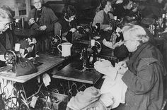 Forced laborers at work in a tailor's workshop. Theresienstadt ghetto, between 1941 and 1945.