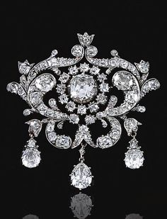 THE ESTATE OF CHRISTIAN, LADY HESKETH Diamond brooch, mid century.The central old-mine diamond in a cut-down collet within open work surrounds designed as foliate scrolls set with old-mine diamonds, suspending three pear-shaped diamond drops Art Deco Jewelry, Jewelry Gifts, Jewelery, Fine Jewelry, Jewelry Design, Jewellery Box, Damas Jewellery, Jewellery 2017, Prom Jewelry