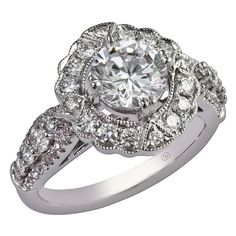 Gottlieb & Sons 29323 - An elegant creation, a semi-mount diamond ring features a halo of bead set round diamonds and shared prong set side diamonds to accent a diamond or gemstone of your choice. Filigree indicates a vintage inspiration.