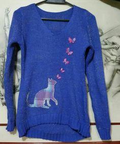 Buso en lana azul morado con apliquez en tela