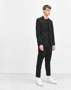 A fashion-forward piece for the modern man, these cropped trousers feature a dropped crutch. Crafted from a slightly stretchy wool blend, this style features pressed creases and a hidden button closure for a smart look.<br><br> • Cropped length<br> • Dr