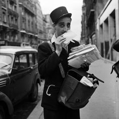 1956: A French postal worker makes sure to smell each envelope before delivery to ensure it has been spritzed with the right amount of Chanel No. 5.