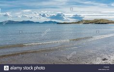 Download this stock image: A view of Llanddwyn Island from beach at Newborough - FY0CF6 from Alamy's library of millions of high resolution stock photos, illustrations and vectors.