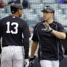 New York Yankees first baseman Mark Teixeira, right, talks with Alex Rodriguez (13) during a spring training baseball workout, Thursday, Feb. 26, 2015, in Tampa, Fla. (AP Photo/Lynne Sladky)