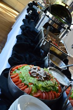 Decorative use of chafing dishes on a buffet table set up for Buffet cuisine en pin