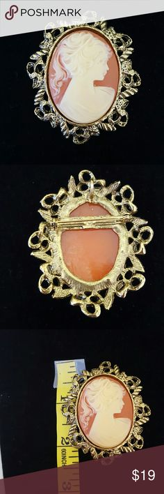 "Cameo Brooch Goldtone frame Loop on back for chain. Can be worn as necklace. 2 1/2"" Length Jewelry Brooches"