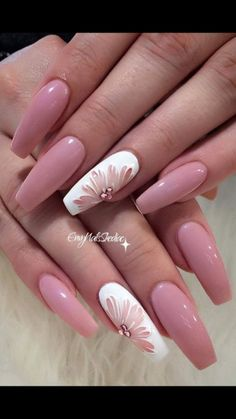 Pink gel coffin nails with floral accent nail perfect for spring or summer