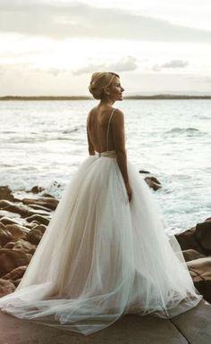 Stunning low open back tulle ballgown skirt beach wedding dress; Featured Dress: Darb Bridal Couture