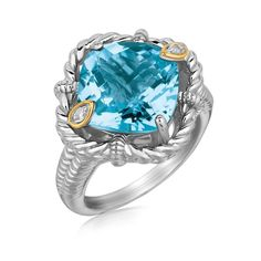 A sterling silver ring radiating charming style with its cushion blue topaz head bordered with a rope inspired rim detaling and 18K yellow gold accented diamond