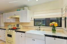 Retro Kitchen With Yellow Stove and Apron Sink   HGTV