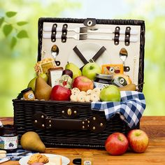 Perfect Picnic Gift Basket - Our elegant wicker picnic basket is filled with delicious treats - an orchard selection of apples and pears, beef summer sausage, cheddar and smoked gouda cheese, mustard, honey wheat crackers, cookies for dessert and much more!