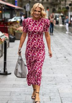 Charlotte Hawkins wearing a puff sleeve printed midi dress and ankles strap sandals | For more style inspiration visit 40plusstyle.com