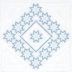 "Cross Stitch only design, with quilting marks. Each package contains six - 18"" x 18"" quilt blocks of cotton/poly broadcloth. Additional materials needed to"