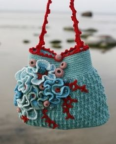 wonderful crochet bag by susanna (love everything but the poofy things on the front.)
