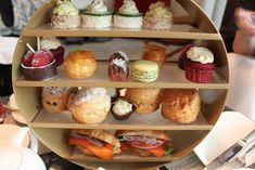 Grand tea stand of sandwiches and desserts! The BEST Afternoon Tea in Toronto. Ritz Carlton Hotel.