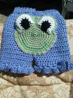 Crocheted baby bloomers. The frog is the back of the pants
