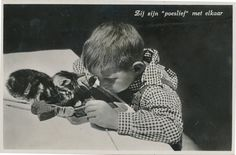 "30.  This boy and his cat working on a project, 1940 | 40 Sweet Cat Photos Of The '40s . . . . . ""zij zijn 'poeslief' met elkaar"" = ""They are 'sweetly' together."""