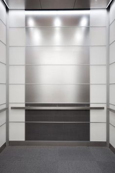 LEVELe-103 Elevator Interior with main panels in Stainless Steel with Seastone finish; lower panels in Bonded Aluminum with Dark Patina and Charleston pattern; accent panels in ViviChrome Chromis glass with White interlayer and Opalex finish; Rectangular handrail in Satin Stainless Steel at 1600 Market Street, Philadelphia, Pennsylvania
