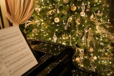 Let the Christmas spirit envelop you as you listen to carols on the grand player piano at Blessings on State Bed & Breakfast, Jacksonville, IL.