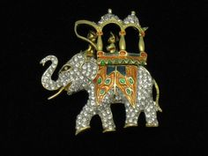 Kenneth Lane KJL Circa 1960  Rhinestone Howdah Elephant Brooch. Affordable, Collectible, Gifts of Designer Jewelry at http://www.rubylane.com/shop/atouchofrosevintagejewels
