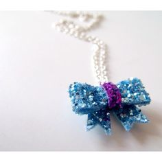 tiny blue and purple glitter bow necklace ($14) ❤ liked on Polyvore