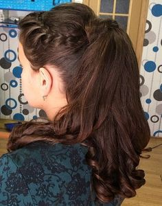 curly pony with a side braid