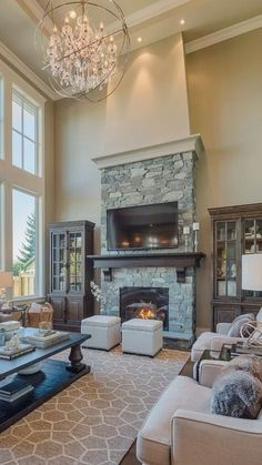 #homedesign #livingroomdecor #inspiration | Photo of a mid-sized traditional open concept living room in Vancouver with beige walls, dark hardwood floors, a standard fireplace, a stone fireplace surround and a wall-mounted tv. — Houzz