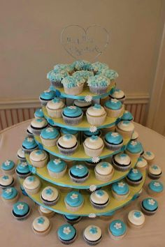 Turquoise and white cupcake tree. #wedding #weddingcakes #cupcakes
