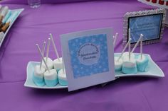 Blue chocolate dipped marshmellows. Frozen themed party.