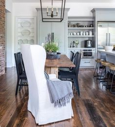 Beautiful simple kitchen and dinning area! Love the gray cabinets and open shelving!