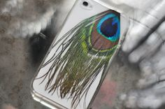 Design your own iPhone case using clear plastic cover. I am TOTALLY doing the peacock feather!