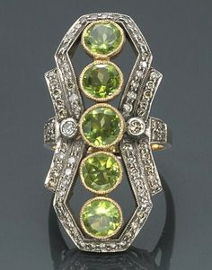 A peridot and diamond ring  mounted in silver-topped eighteen karat gold