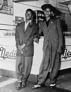 Zoot suits. A zoot suit is a men's suit with high-waisted, wide-legged, tight-cuffed, pegged trousers, and a long coat with wide lapels and wide padded shoulders.