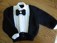 papyonlu siyah beyaz örgü bebek hırkası modeli