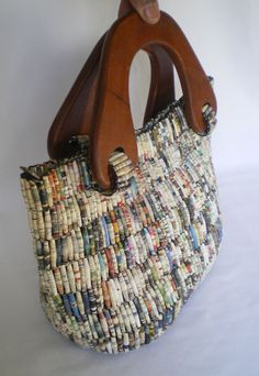 A beautifully crafted bag, handmade from beads rolled from recycled magazine paper BIG TIME COMMITMENT BUT WORTH IT.