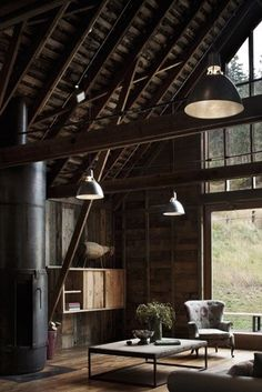 Rustic wood beams paired with huge industrial lights and high vaulted ceilings