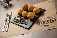 Cheese croquettes with Graviera Naxou, smoked graviera and Kefalotiri, accompanied with fig jam. Tomato Beef Stew, Pork Leg, Grilled Lamb Chops, Tomato Jam, Fig Jam, Cheese Bites, Lemon Sauce, Fried Pork, Food Photography